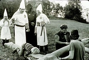 English: KKK preparing a cross to be burned in...