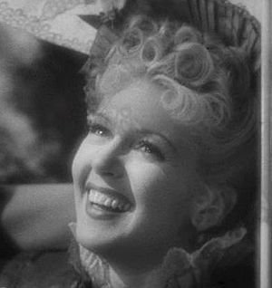 This screenshot shows Lana Turner in a carriage.