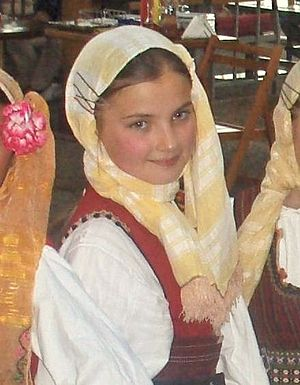 A Macedonian girl in a traditional folk costume
