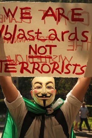 English: Demonstrator with a Guy Fawkes mask i...