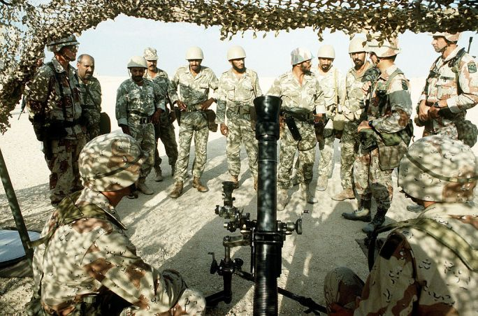 A member of the 1st Battalion, 325th Airborne Infantry Regiment, explains the M252 81mm mortar to Saudi Arabian national guardsmen