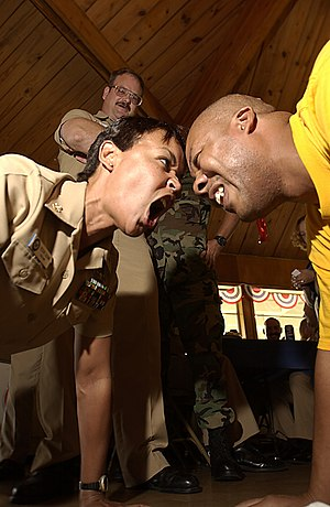 US Navy Chief Yeoman (Select) Joseph Melton, 37, receives some individualized push-up training