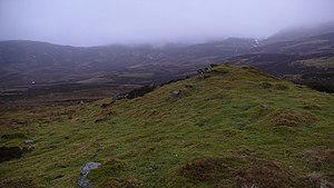 English: Grassy knoll on hillside A rare area ...