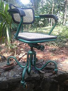 swivel chair definition compact table and chairs wikipedia an old