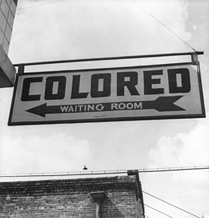 """Sign for """"colored"""" waiting room at a..."""