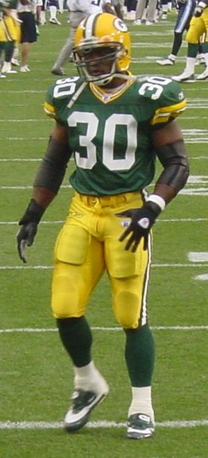 English: Ahman Green warming up for a preseaso...