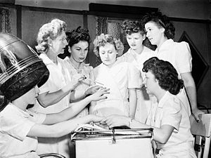Ex-servicewomen learning manicure techniques d...