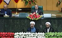 Hassan Rouhani taking oath of office in the Iranian Parliament with Chief Justice Sadeq Larijani at his left