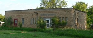 Abandoned school building in ; seen from the s...