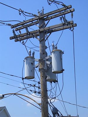 English: A 'transformer bank' on a utility pol...