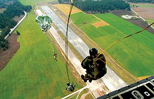 Military static line jump, from the rear of a ...