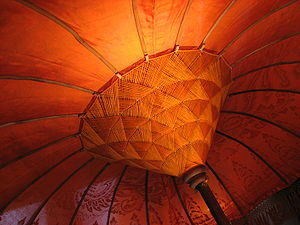 English: An orange cloth umbrella. Français : ...