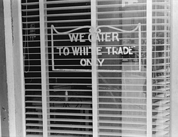 "Sign on a restaurant: ""We Cater to White ..."