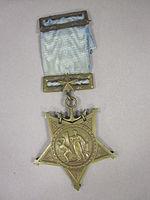 Star-shaped medal on a blue ribbon