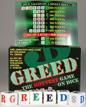 English: $GREED dice game box, dice and scroe card