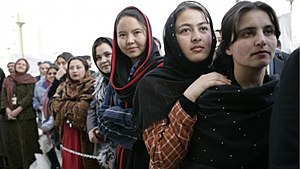 Women of Afghanistan stand outside the U.S. Em...
