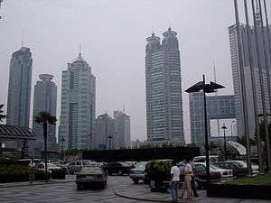 A cluster of skyscrapers stand together in the...