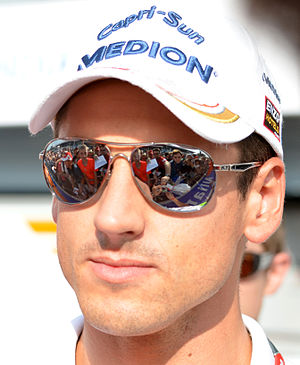 Force India driver Adrian Sutil signs autograp...