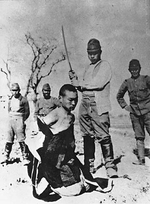 A Chinese POW about to be beheaded by a Japane...