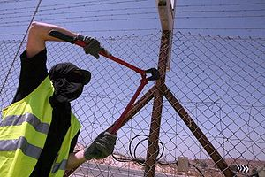 Destroying fences at the border by the AATW, 2007