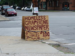 A sign advertising the Homeless Grapevine, a s...