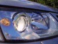 Xenon projector low beam headlamp illuminated on a Saab 9-5.