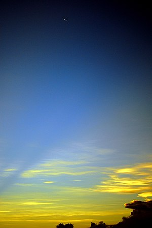 A try to get the moon and also the sunset clou...