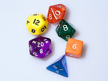 English: Six dice of various colours. 4-sided ...