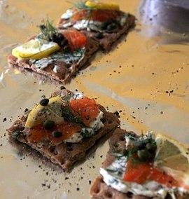 Gravlax on crisp bread, garnished with pepper ...