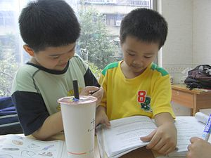 Two students studying English at a Taiwanese c...