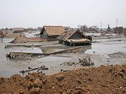 Rumah yang terendam lumpur panas