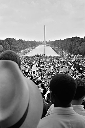 Crowds surrounding the Reflecting Pool, during...