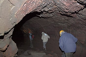 Víðgelmir cave expeditioners walking on top of...