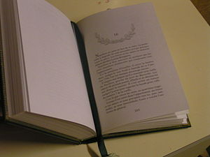 A book with a bound bookmark.