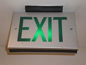 A metal exit sign.