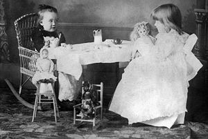 """Two young girls play """"tea party"""" wit..."""