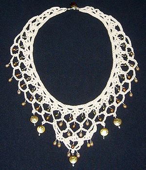 Necklace made from crochet lace, pearls, and s...