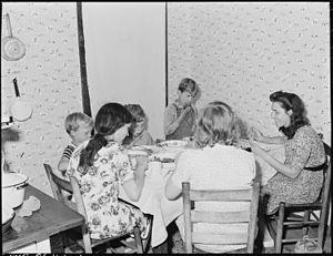 Some of the family eat Sunday dinner, on Sunda...
