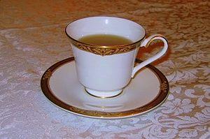A teacup on a saucer.