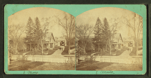 View of a large house, white picket fence in f...