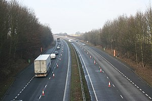 English: Putting out the cones on the A1. A fa...