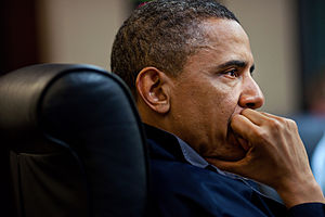 English: President Barack Obama listens during...
