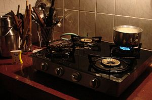 English: What is cooking : a scene in a Indian...