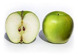 A pair of Granny Smith apples Malus x. domesti...