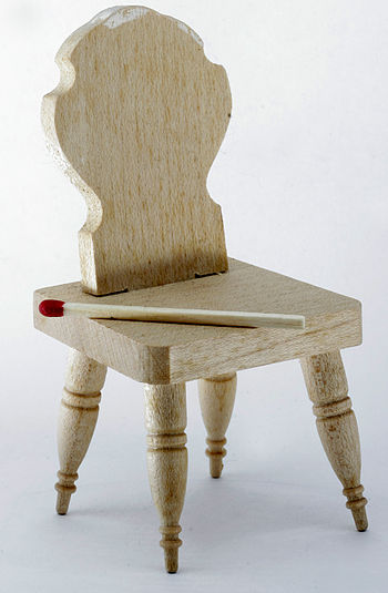 English: Dollhouse chair, with a match as a sc...