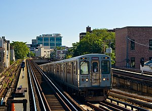 A CTA train emerges from the north portal of t...