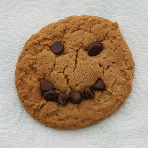 Peanut butter cookie with a chocolate chip smi...