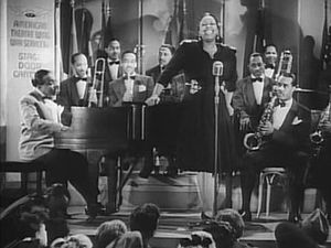 Cropped screenshot of Count Basie and his band...