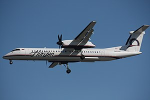 A Horizon Air Bombardier Dash 8-Q402 landing a...