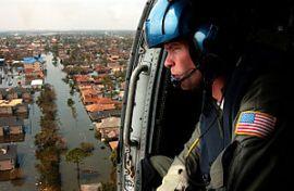 A U.S. Coast Guardsman searches for survivors ...